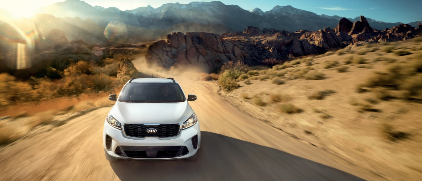 2020 Kia Sorento in white driving on desert road front view