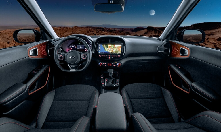 2020 Kia Soul interior in black two front seats showinf the fron dash