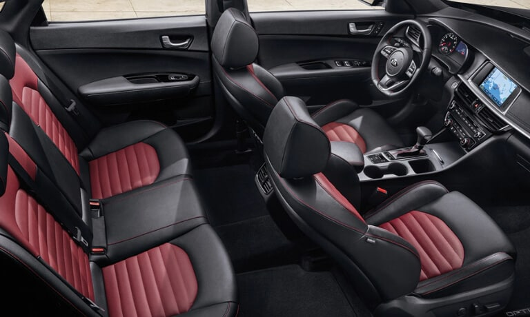 2020 Kia Optima interior in black and red showing top view of the seating