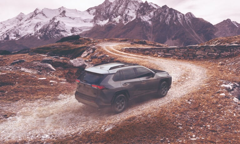 2020 RAV4  in gray drinving on dirt path off road