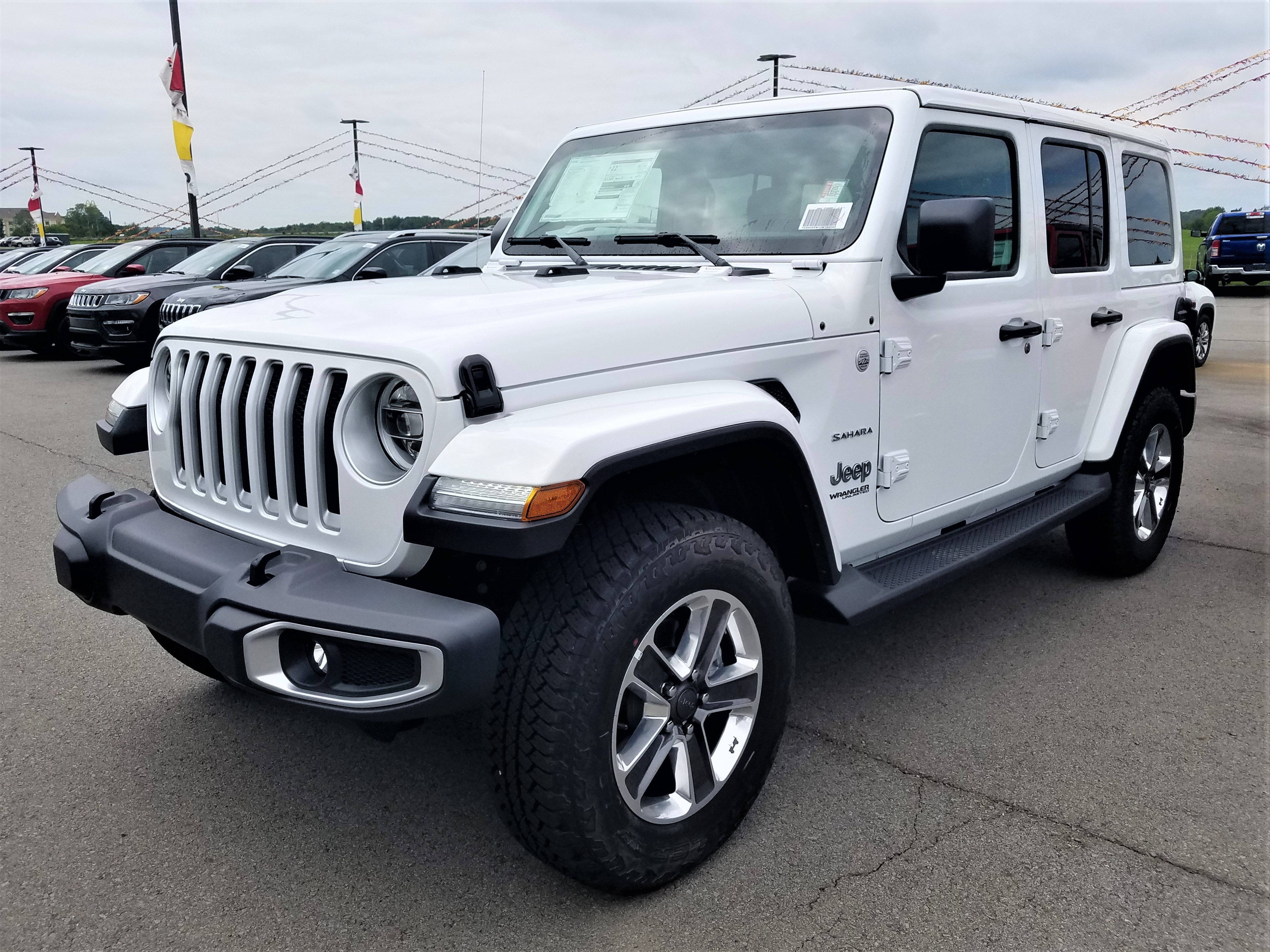 Featured new vehicles 2018 Jeep Wrangler UNLIMITED SAHARA 4X4 Sport Utility for sale near you in Morrilton, AR