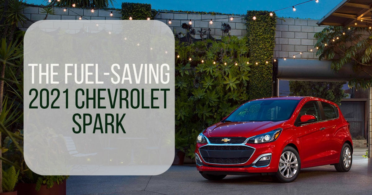 "3/4 Front view of Red Chevrolet Spark in outdoor patio area with words ""the fuel-saving 2021 Chevrolet Spark""."
