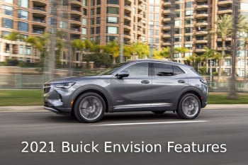 Side view of silver Buick Envision driving