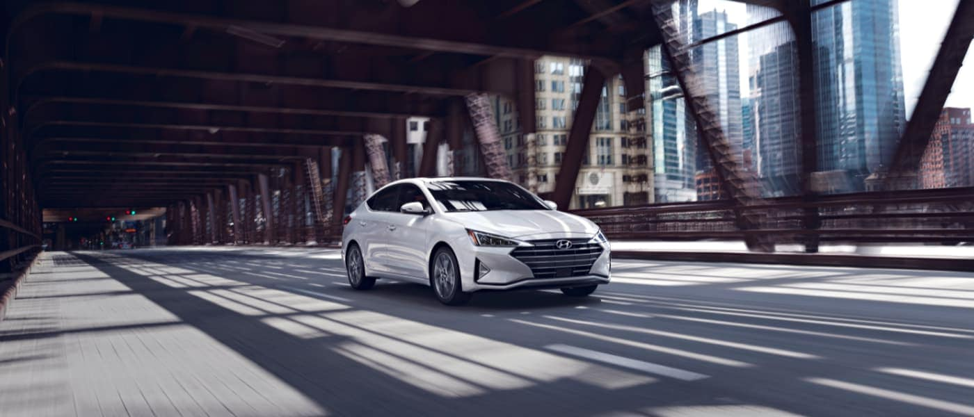 2020 White Hyundai Elantra Driving Over a Bridge