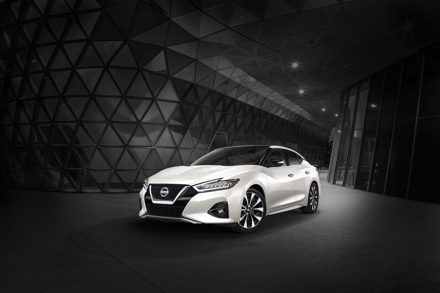 Performance Features of the 2019 Nissan Maxima at Hanover Nissan of Hanover | White 2019 nissan maxima parked on side of building