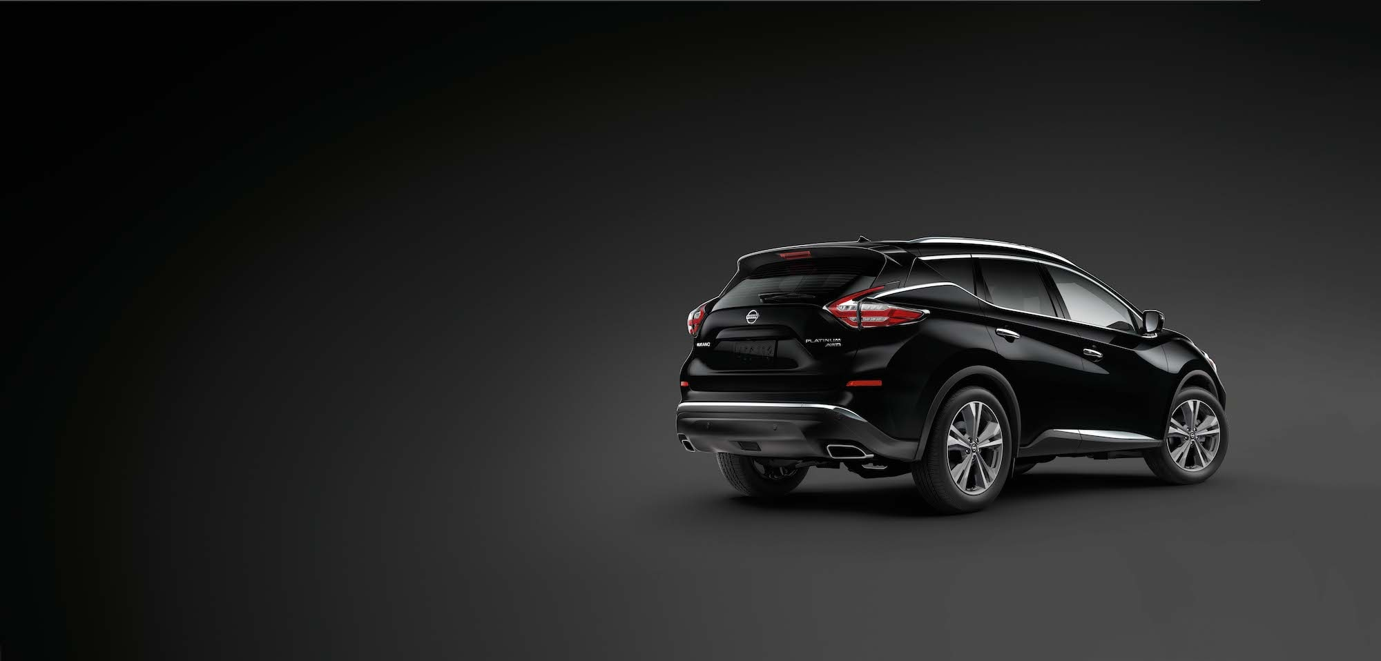 Features of the 2019 Nissan Murano at Hanover Nissan | The rear view of the Black 2019 Murano on a dark background