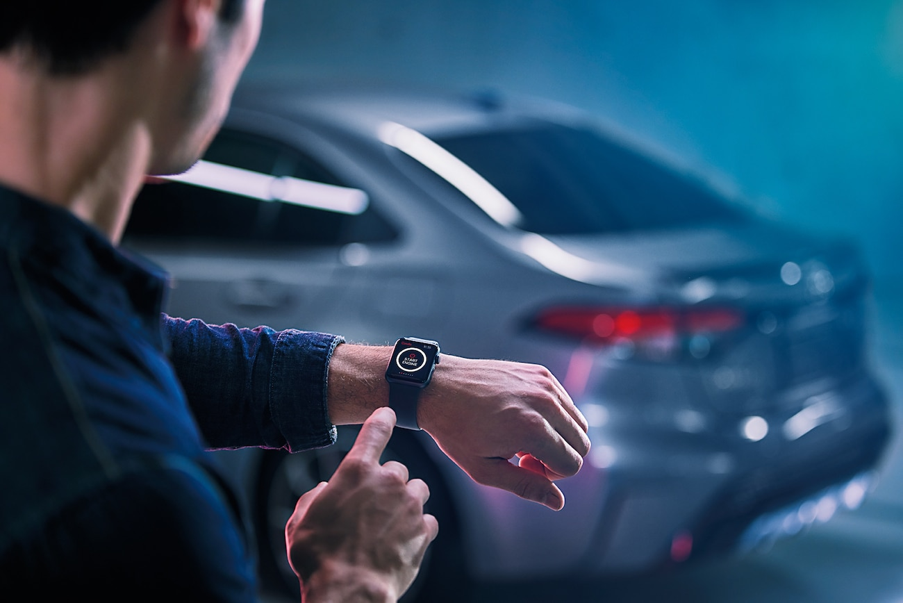 Model Features of the 2020 Toyota Corolla at Hanover Toyota in Hanover | Man Remote control the 2020 toyota corolla with a smartwatch