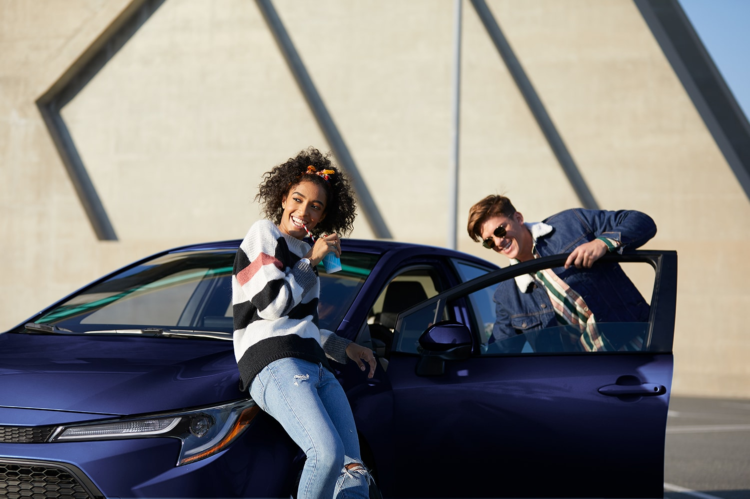 Model Features of the 2020 Toyota Corolla at Hanover Toyota in Hanover | Teenager leaning on the purple 2020 toyota corolla