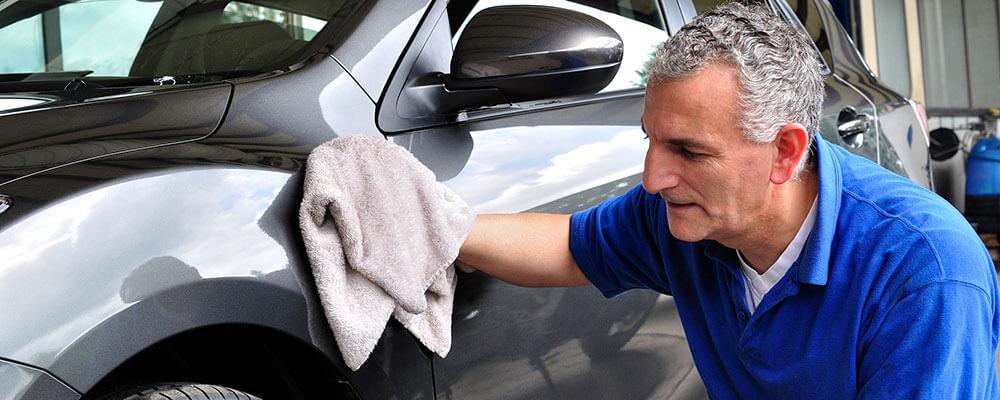 Older Man Waxing a Car