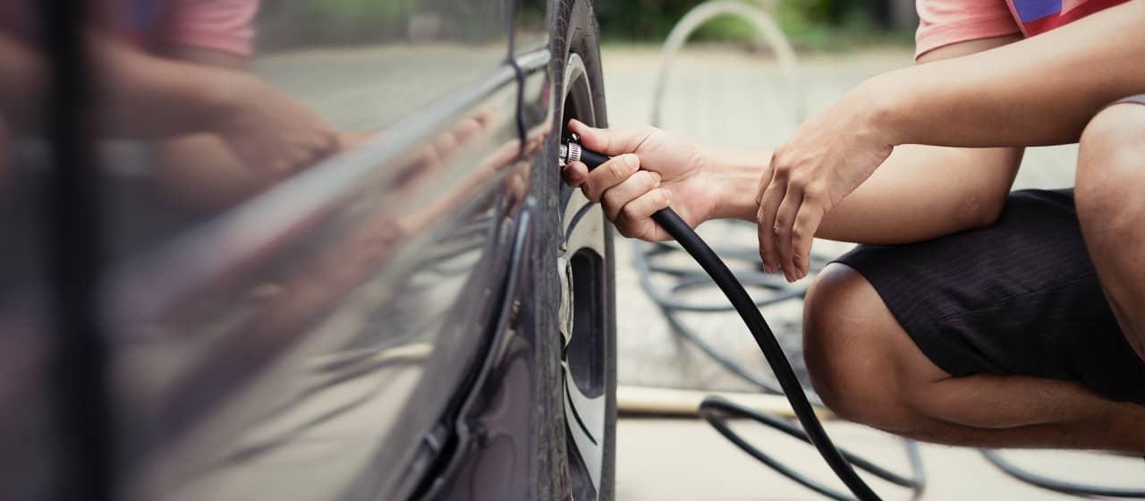 Person checks Tire Pressure