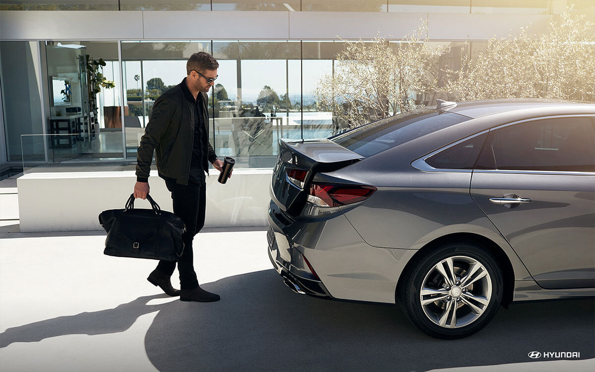 Walking towards trunk of 2018 Hyundai Sonata