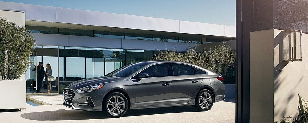 2018 Hyundai Sonata parked in front of home banner