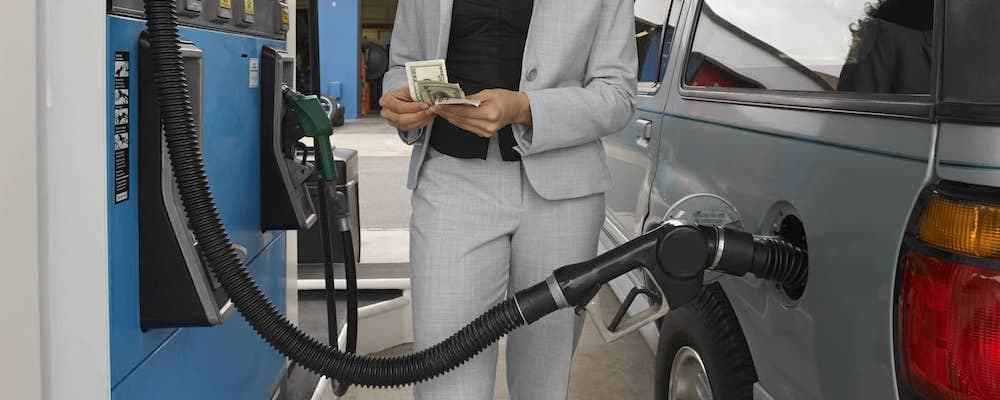 Person pumping gas and counting money