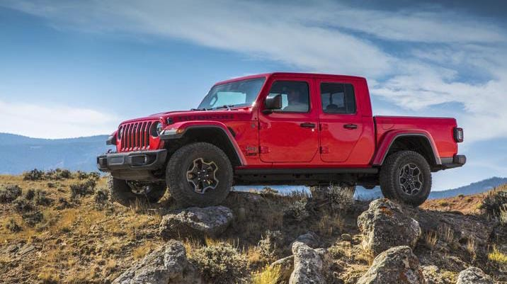 A red 2020 Jeep Gladiator parked on rocks