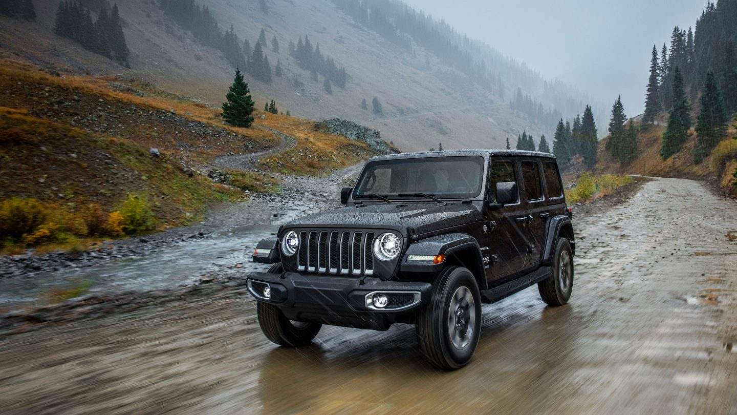 New Gray 2018 Jeep Wrangler Driving Down Trail