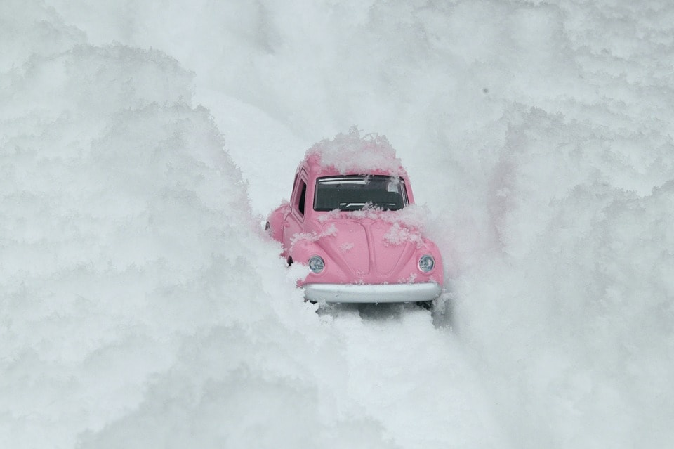 Pink Toy Car Sliding On A Snowy Road