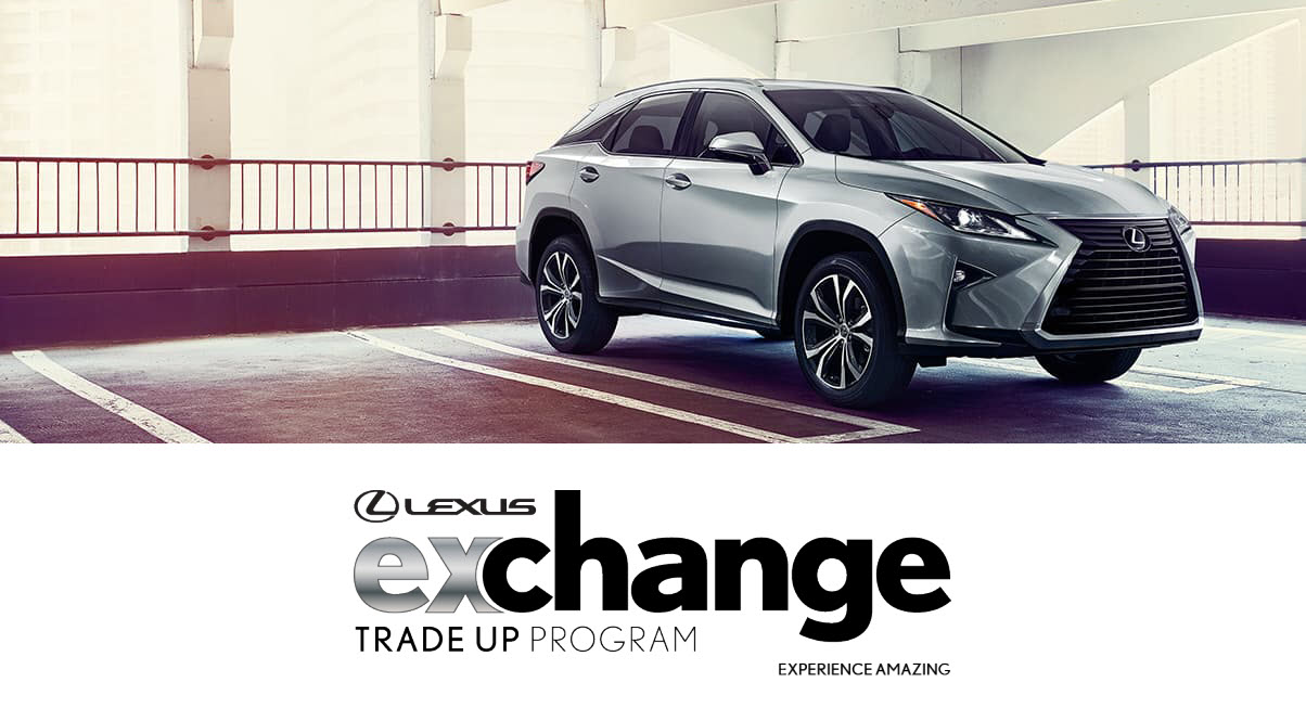 lexus auto technician perfoming service maintenance