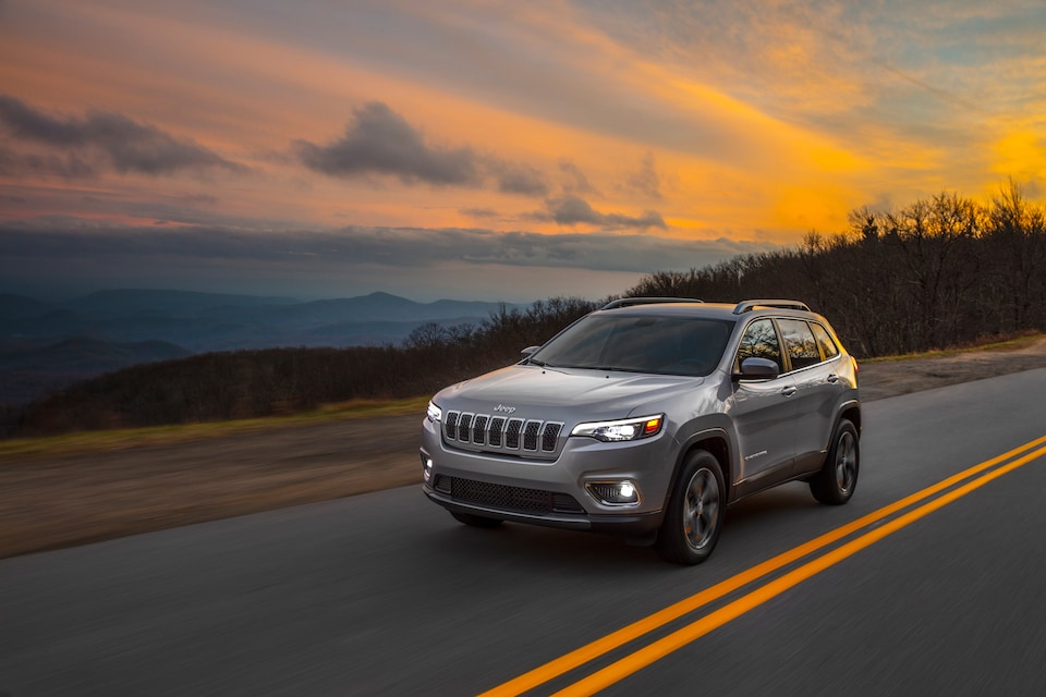 Jeep Cherokee driving through mountains