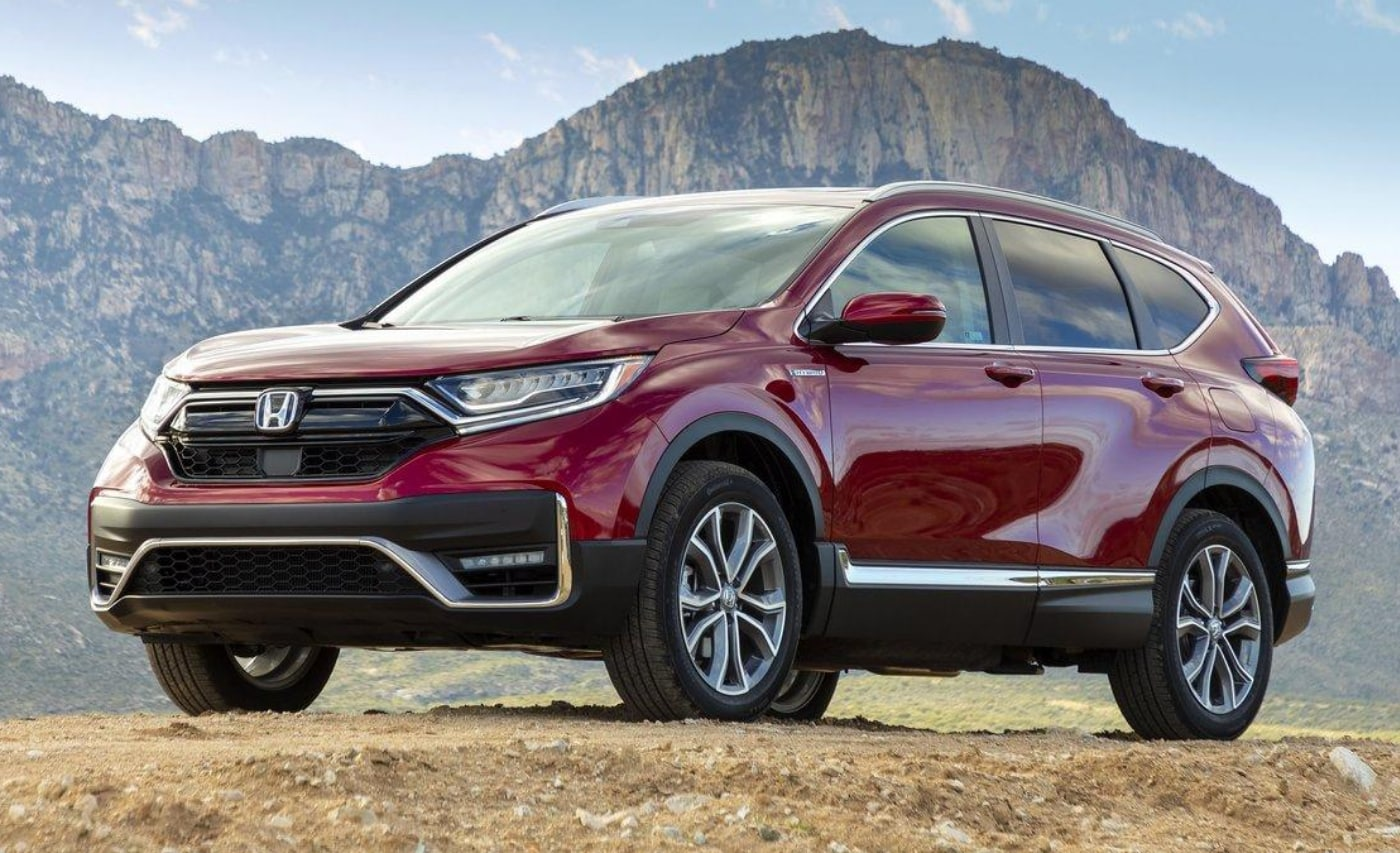 Ground-level exterior view of the 2021 Honda CR-V Hybrid in red exterior color