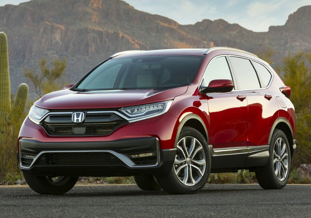 2020 Honda CR-V Hybrid parked in front of a desert mountain range in red color