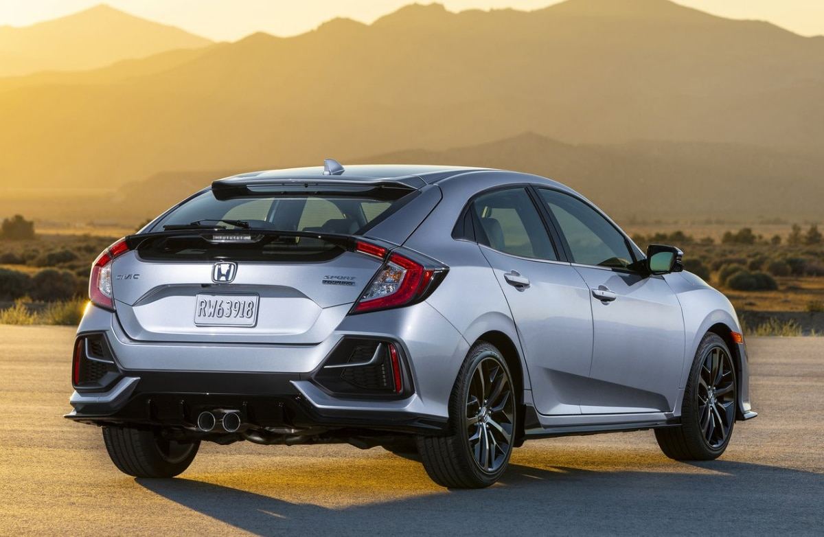 2020 Honda Civic exterior rear side angle bright orange golden yellow sunset over mountain range