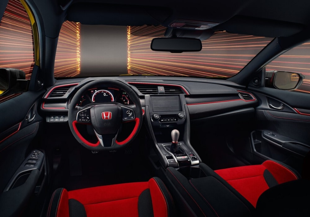 Front interior design inside the upcoming 2021 Honda Civic Type R showing Type R-accented trims and red-black colors