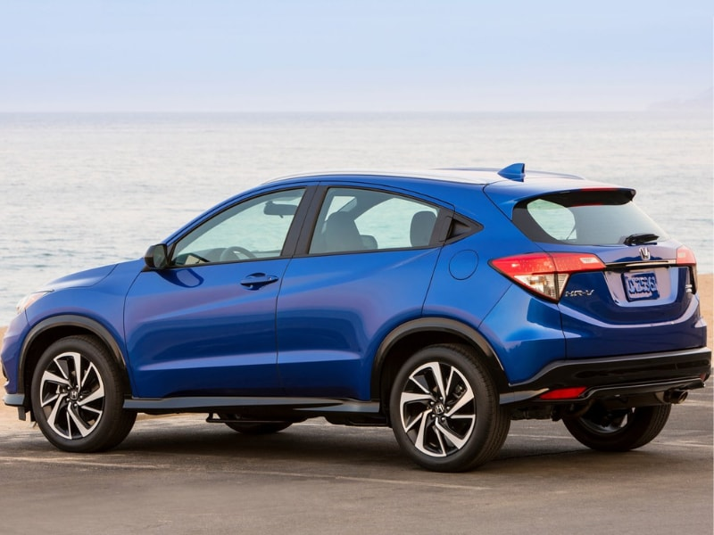 Back Side Exterior of a blue 2019 Honda HR-V in a parking spot by the ocean shore