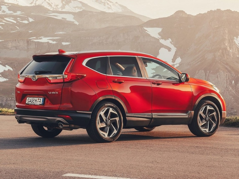 Back side Exterior of a red 2019 Honda CR-V parked in an opening at the base of a snowy mountain