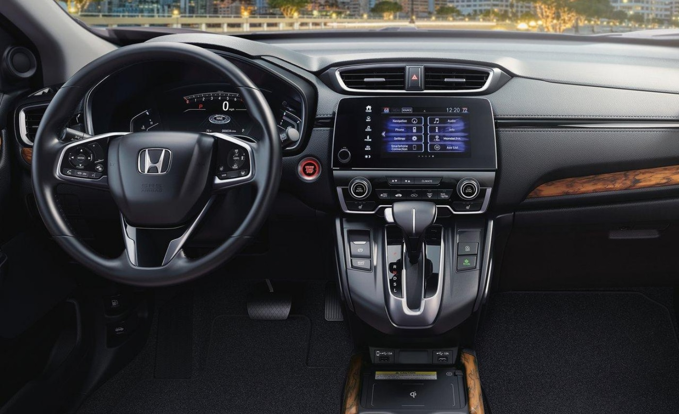 Front interior cabin inside the new 2021 Honda CR-V with wooden trims