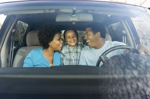 Smiling Family in Car