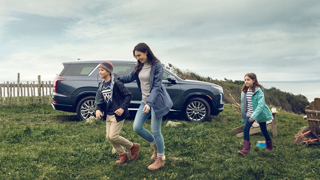 family near new Hyundai