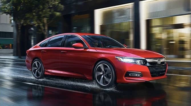 2019 Honda Accord on rainy city street