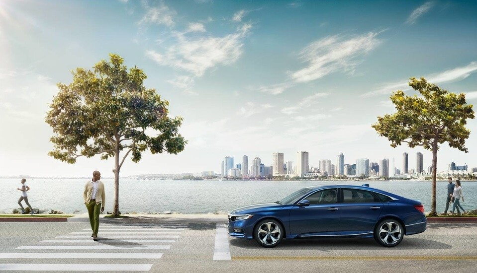 Compare the Honda Accord with the Toyota Camry and Nissan Altima