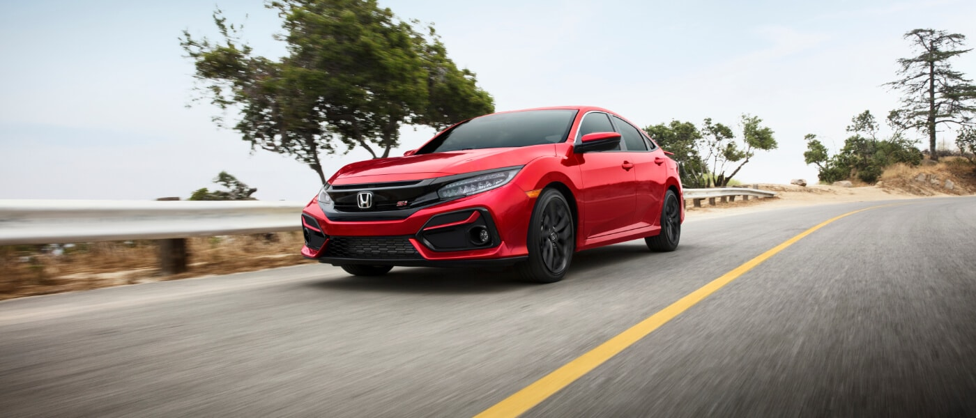 2020 Honda Civic Si in red driving down a road