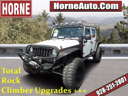 Featured Used 2014 Jeep Wrangler Unlimited Sahara 4WD  Sahara for Sale in Show Low, AZ