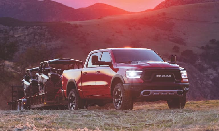 2021 Ram 1500 exterior towing in field during sunset