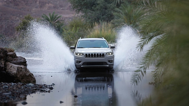 2020 Jeep Cherokee driving through water