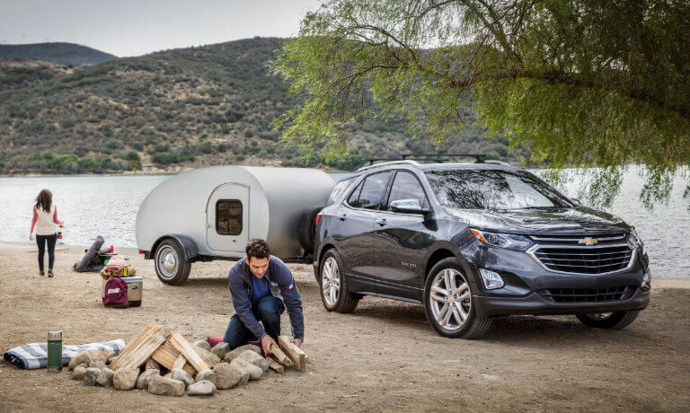 2021 Chevy Equinox exterior family at campsite by river