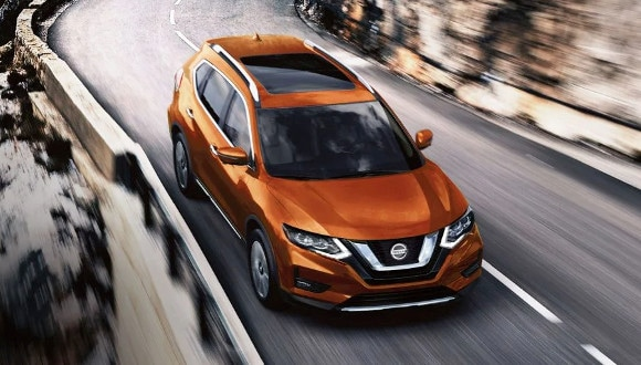 2020 Nissan Rogue towing a boat