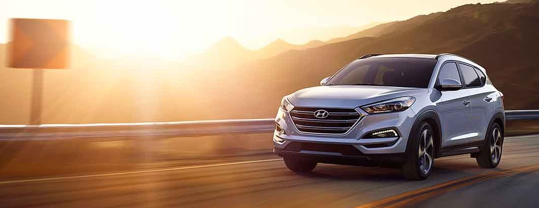 Hyundai driving on a road bathed in sunlight