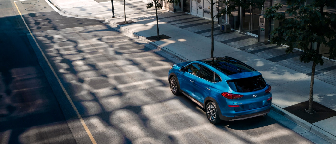 A blue 2020 Hyundai Tucson on road