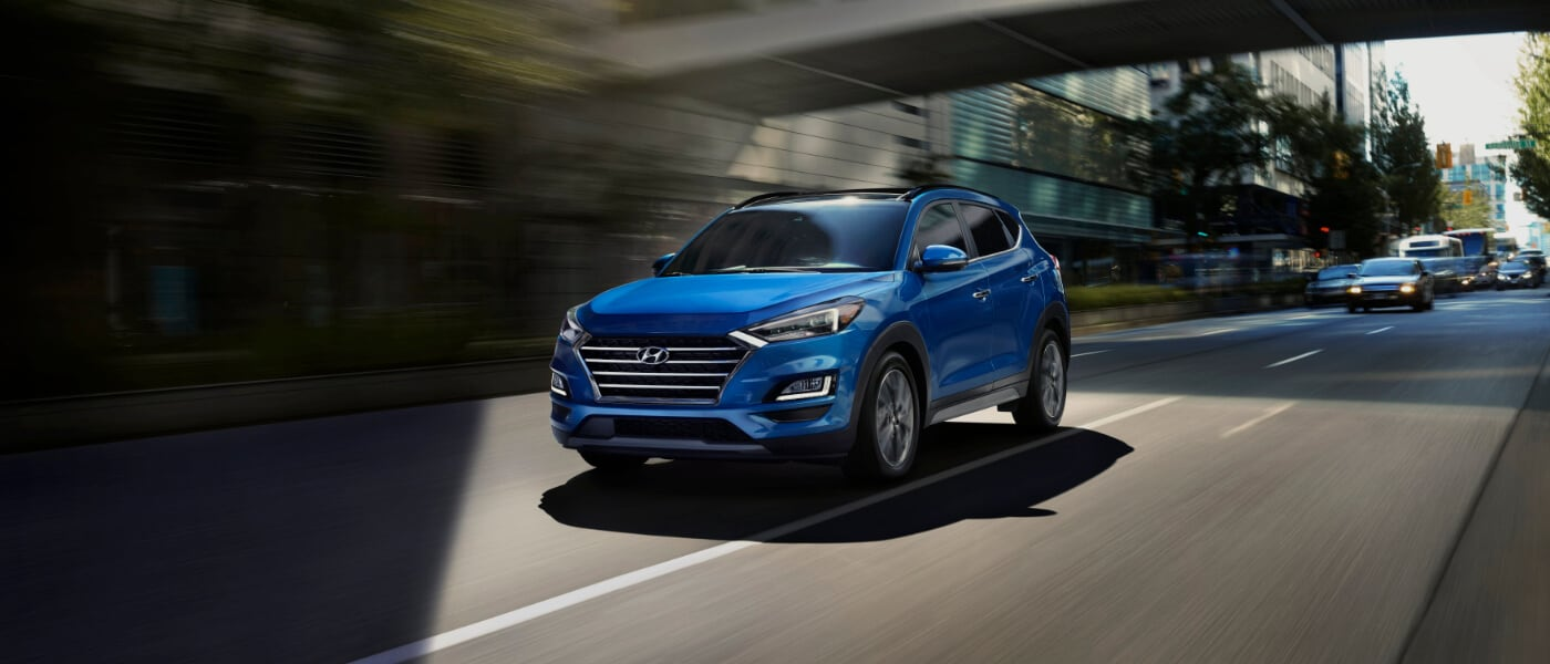 Blue 2021 Hyundai Tucson on road