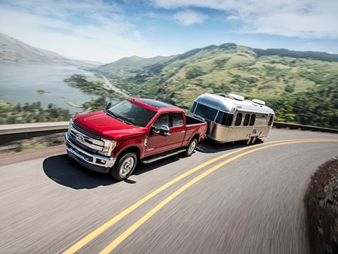 2019 Ford F-250 driving with trailer