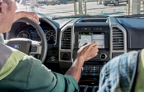 Two construction workers using the SYNC System in the Ford F-150