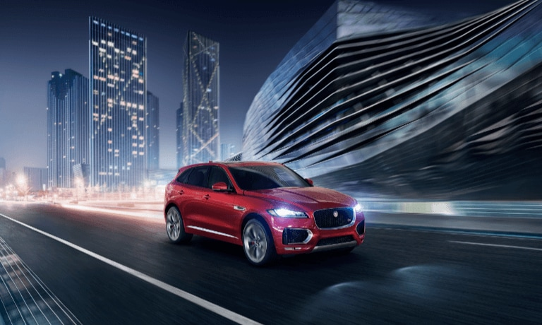 2020 Jaguar F-PACE driving through the city