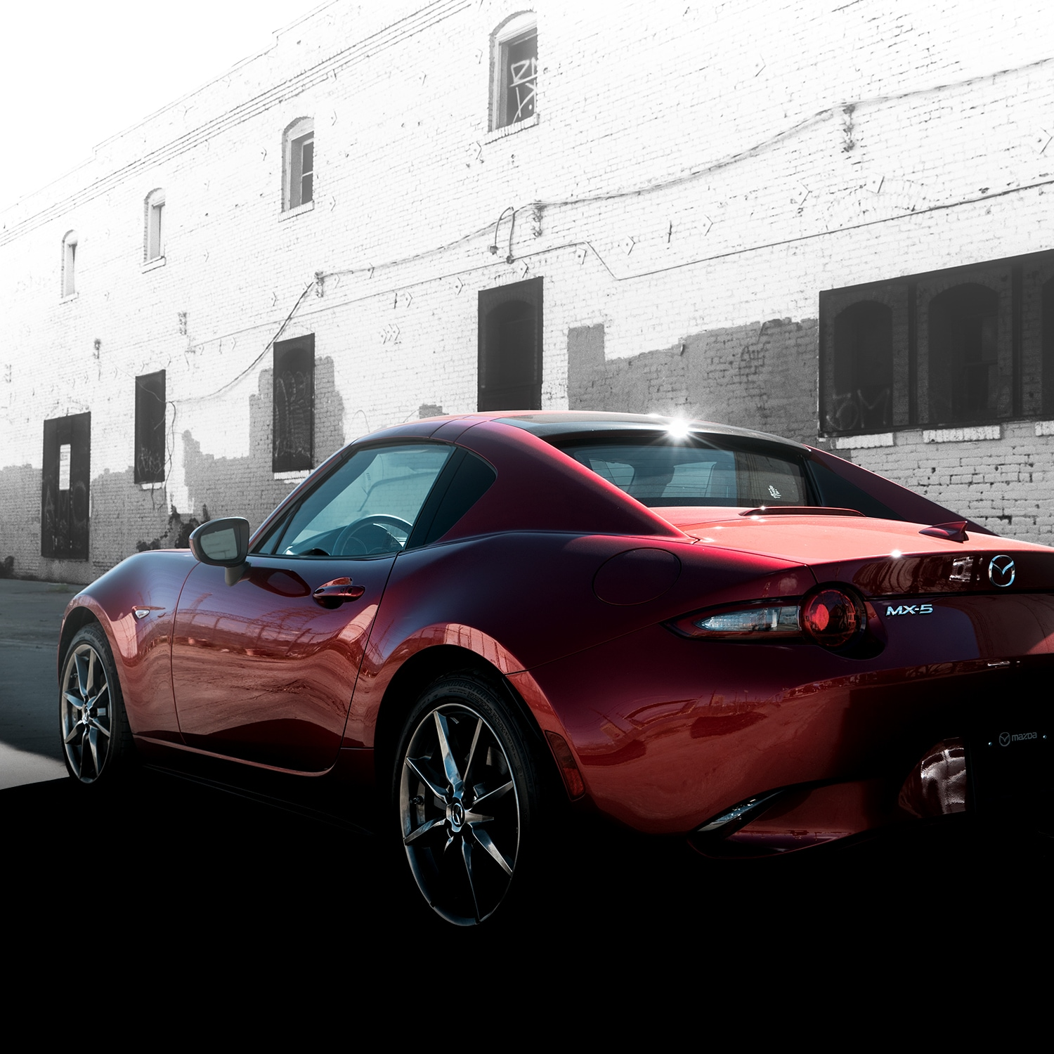 Jack Giambalvo Mazda is a Car Dealership near Lancaster PA | Rear view of 2020 Mazda Miata parked in alley