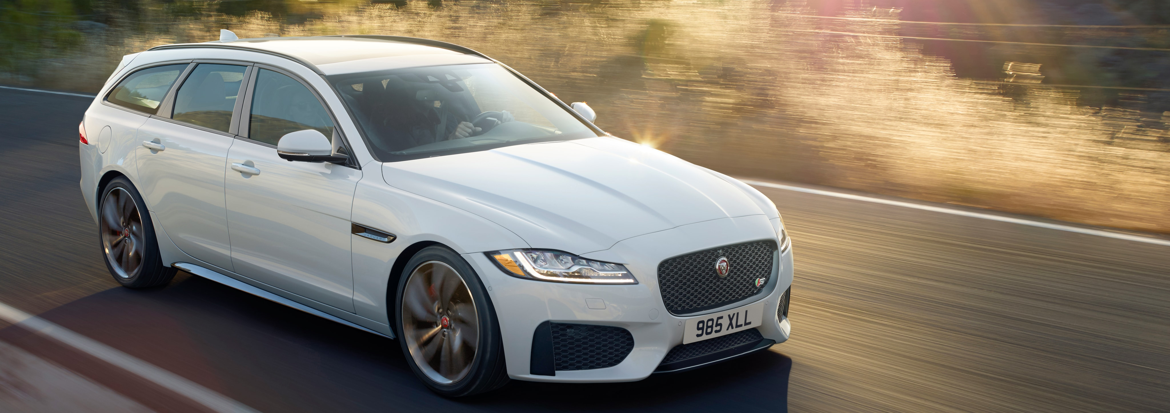 Exterior of the Jaguar XF Sportbrake in motion.