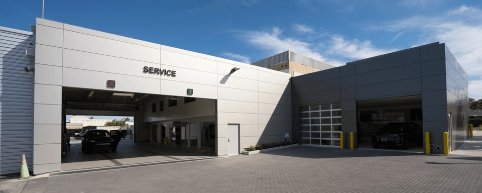Exterior view of Jaguar South Bay's service center entrance during the day