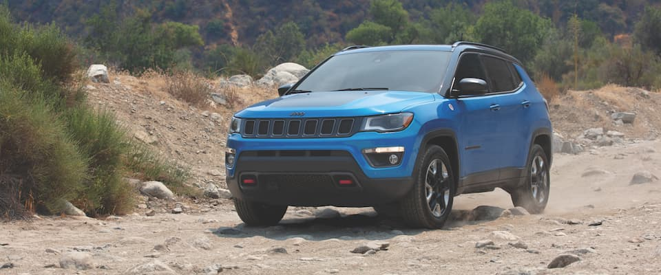 A blue Jeep Cherokee offroading