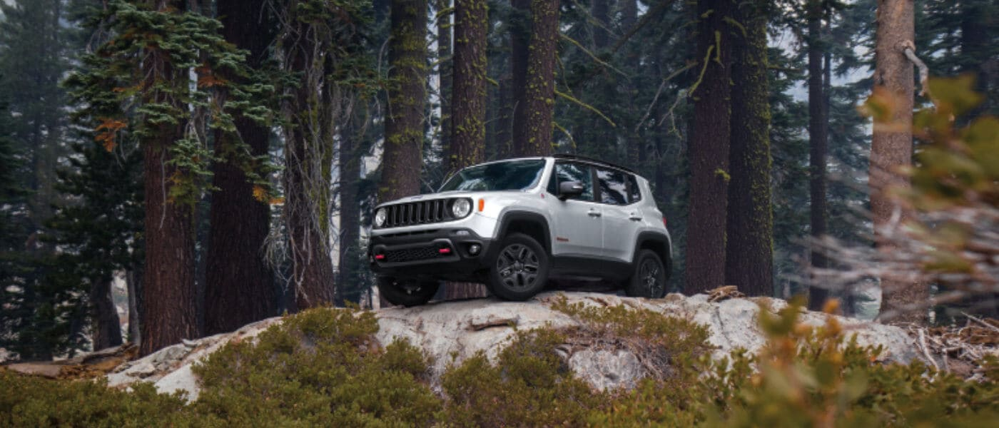 2020 Jeep Renegade driving on a boulder
